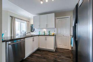 """Photo 2: 201 3880 CHATHAM Street in Richmond: Steveston Village Condo for sale in """"Steveston Village"""" : MLS®# R2039827"""