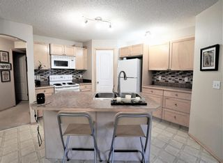 Photo 9: 104 3 EVERRIDGE Square SW in Calgary: Evergreen Row/Townhouse for sale : MLS®# A1143635