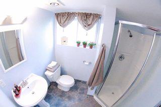 Photo 14: 1491 COMO LAKE AV in Coquitlam: Harbour Place House for sale : MLS®# V979371