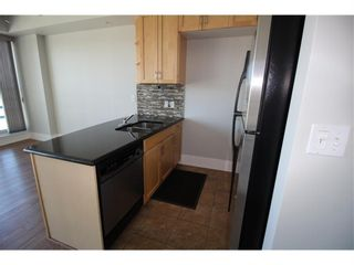 Photo 2: 602 205 Riverfront Avenue SW in Calgary: Chinatown Apartment for sale : MLS®# A1141422
