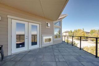 Photo 7: 40 Cougar Ridge Landing SW in Calgary: Cougar Ridge Row/Townhouse for sale : MLS®# A1148928