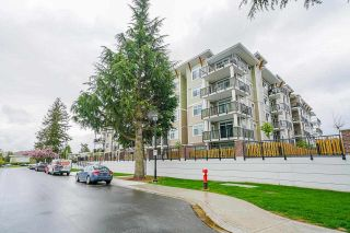 """Photo 1: 418 20696 EASTLEIGH Crescent in Langley: Langley City Condo for sale in """"The Georgia"""" : MLS®# R2574305"""