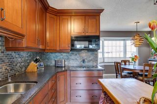 Photo 4: 436 38 Street SW in Calgary: Spruce Cliff Detached for sale : MLS®# A1097954