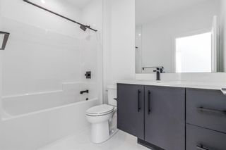 Photo 37: 7853 8A Avenue SW in Calgary: West Springs Detached for sale : MLS®# A1136445