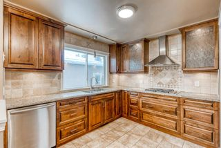 Photo 6: 220 78 Avenue SE in Calgary: Fairview Detached for sale : MLS®# A1063435