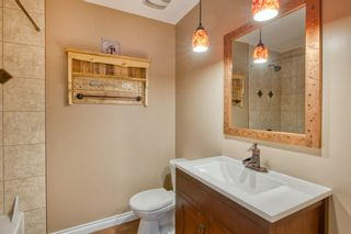 Photo 17: 131 Queensland Circle SE in Calgary: Queensland Detached for sale : MLS®# A1148253