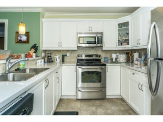 """Photo 5: 407 8084 120A Street in Langley: Queen Mary Park Surrey Condo for sale in """"Eclipse"""" (Surrey)  : MLS®# R2333868"""
