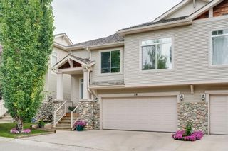 Photo 1: 26 7401 Springbank Boulevard SW in Calgary: Springbank Hill Semi Detached for sale : MLS®# A1139691