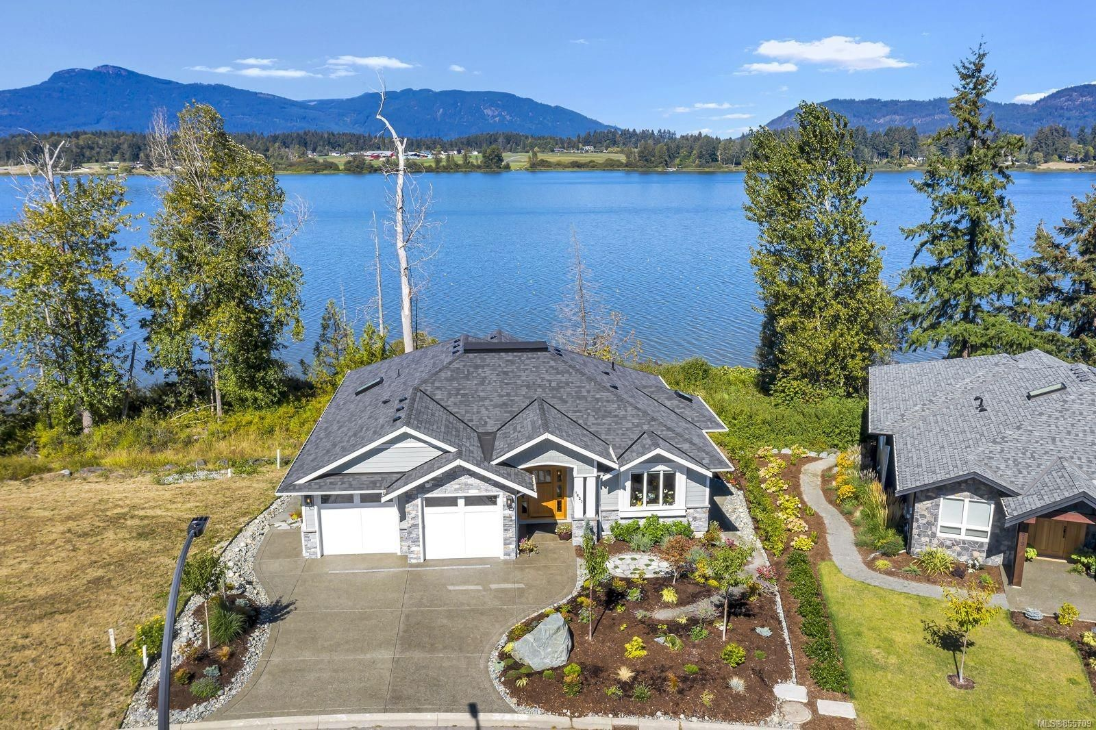 Professionally landscaped lake front home