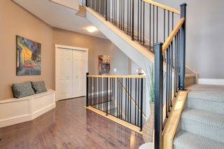Photo 4: 131 Cougar Plateau Circle SW in Calgary: 2 Storey for sale : MLS®# C3614218