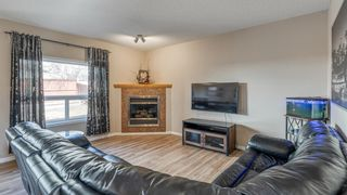 Photo 7: 32 ROCKYWOOD Park NW in Calgary: Rocky Ridge Detached for sale : MLS®# A1091115