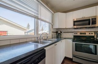 Photo 12: 75 SUMMERWOOD Road SE: Airdrie House for sale : MLS®# C4174518