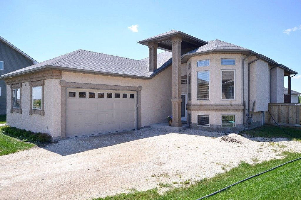 "SENSATIONAL 1200sf Raised Bungalow Custom Built by ""Foster Built Homes"" '08 on Landscaped & Fenced pie lot in Town of Oakbank. Home features 2 bedrooms up & 1 in Fully Finished Basement."