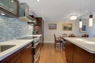 """Photo 23: 301 1470 PENNYFARTHING Drive in Vancouver: False Creek Condo for sale in """"Harbour Cove"""" (Vancouver West)  : MLS®# R2563951"""
