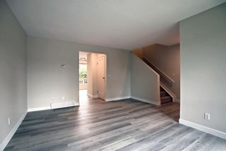 Photo 10: 77 123 Queensland Drive SE in Calgary: Queensland Row/Townhouse for sale : MLS®# A1145434