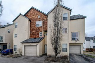 Photo 3: 312 BRIDLEWOOD Lane SW in Calgary: Bridlewood Row/Townhouse for sale : MLS®# A1046866