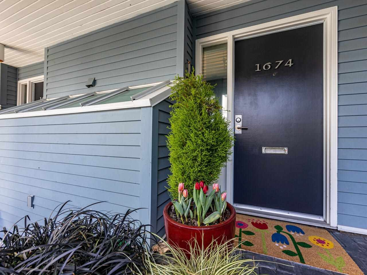 """Main Photo: 1674 ARBUTUS Street in Vancouver: Kitsilano Townhouse for sale in """"Arbutus Court"""" (Vancouver West)  : MLS®# R2561294"""