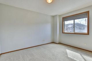 Photo 21: 93 Rocky Vista Circle NW in Calgary: Rocky Ridge Row/Townhouse for sale : MLS®# A1071802