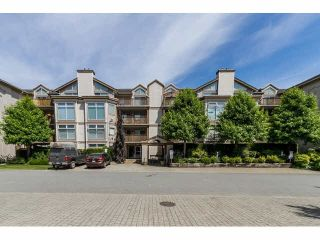 """Photo 1: 405 19131 FORD Road in Pitt Meadows: Central Meadows Condo for sale in """"WOODFORD MANOR"""" : MLS®# R2107108"""