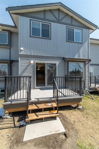 Photo 39: 404 720 Willowbrook Road NW: Airdrie Row/Townhouse for sale : MLS®# A1098346