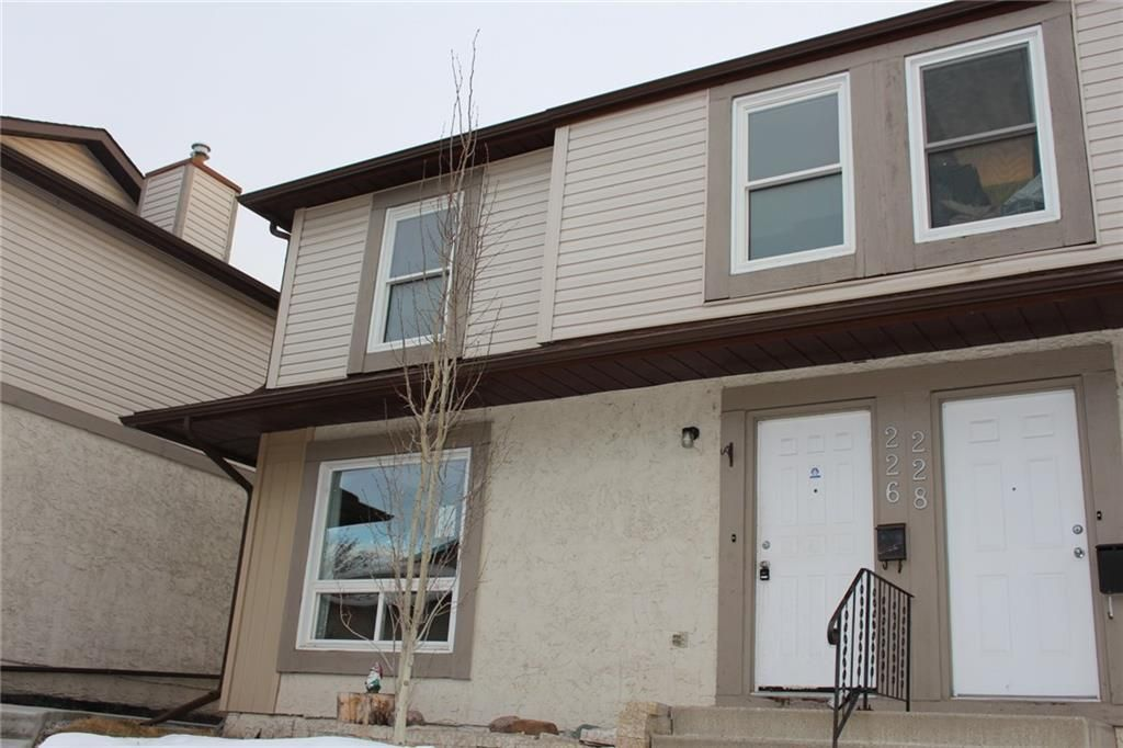 Main Photo: 226 DEERPOINT Lane SE in Calgary: Deer Ridge Row/Townhouse for sale : MLS®# C4282860