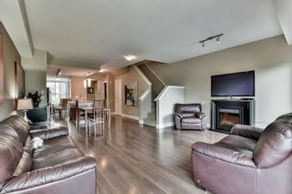 """Photo 5: 211 2110 ROWLAND Street in Port Coquitlam: Central Pt Coquitlam Townhouse for sale in """"AVIVA ON THE PARK"""" : MLS®# R2094344"""