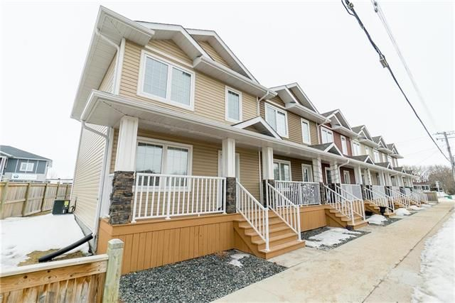 Welcome to #1-414 Main Street in Ile Des Chene! Nice end unit location.
