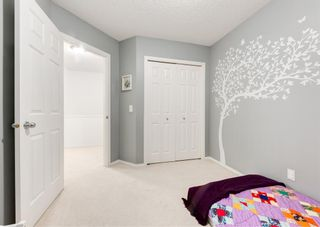 Photo 33: 218 950 ARBOUR LAKE Road NW in Calgary: Arbour Lake Row/Townhouse for sale : MLS®# A1136377
