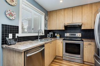 Photo 5: 100 Martinwood Road NE in Calgary: Martindale Detached for sale : MLS®# A1071596