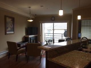 Photo 7: 405 8168 120A Street in Surrey: Queen Mary Park Surrey Condo for sale : MLS®# R2057416