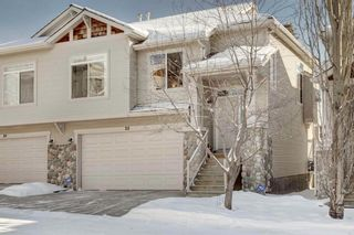 Photo 1: 22 7401 Springbank Boulevard SW in Calgary: Springbank Hill Semi Detached for sale : MLS®# A1068939