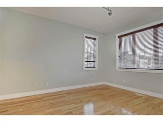 Photo 3: 176 MIKE RALPH Way SW in Calgary: Garrison Green House for sale : MLS®# C4091127