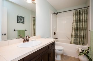 """Photo 19: 411 20281 53A Avenue in Langley: Langley City Condo for sale in """"Gibbons Layne"""" : MLS®# R2621680"""