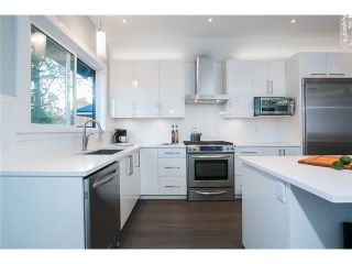 Photo 3: 1630 E 13TH AV in Vancouver: Grandview VE House for sale (Vancouver East)  : MLS®# V1032221