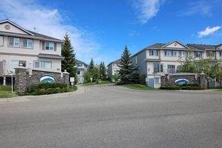 Photo 9: 219 Rocky Vista Circle NW in Calgary: Rocky Ridge Row/Townhouse for sale : MLS®# A1074376