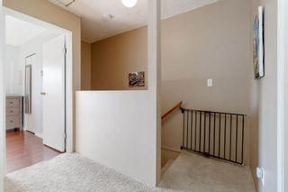 """Photo 19: 905 BRITTON Drive in Port Moody: North Shore Pt Moody Townhouse for sale in """"WOODSIDE VILLAGE"""" : MLS®# R2457346"""