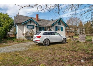 Photo 1: 20037 56 Avenue in Langley: Langley City House for sale : MLS®# R2558038