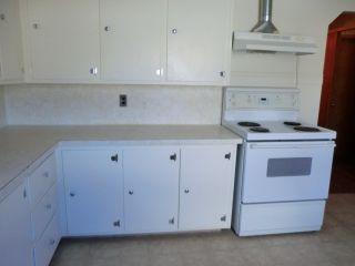 Photo 11: 204 CENTRE Avenue: Cochrane House for sale : MLS®# C4055784