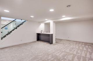 Photo 28: 7411 7 Street SW in Calgary: Kingsland Detached for sale : MLS®# A1021335