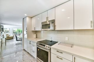 Photo 9: 105 12 LAGUNA COURT in New Westminster: Quay Condo for sale : MLS®# R2409518
