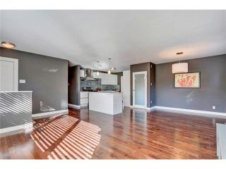 Photo 9: 5612 LADBROOKE Drive SW in Calgary: Lakeview House for sale : MLS®# C4036600