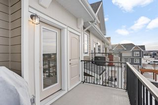 Photo 13: 109 Cranbrook Walk SE in Calgary: Cranston Row/Townhouse for sale : MLS®# A1062566