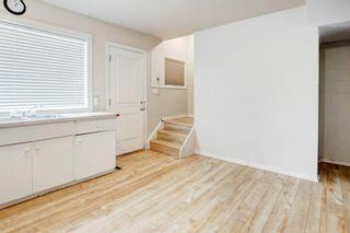 Photo 8: 411 Goddard Avenue NE in Calgary: Greenview Row/Townhouse for sale : MLS®# A1119433