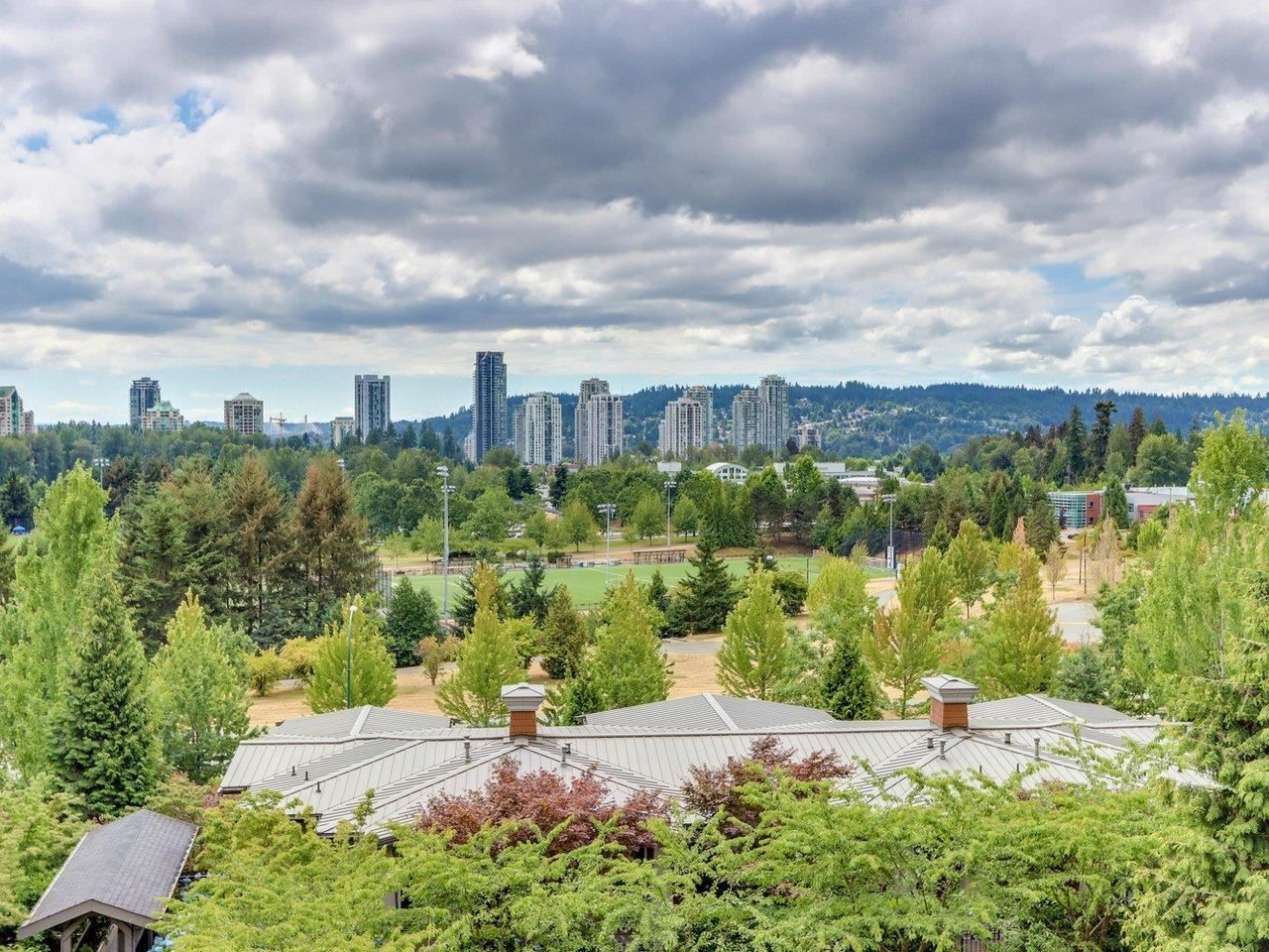 """Main Photo: 317 3082 DAYANEE SPRINGS Boulevard in Coquitlam: Westwood Plateau Condo for sale in """"The Lanterns"""" : MLS®# R2616558"""