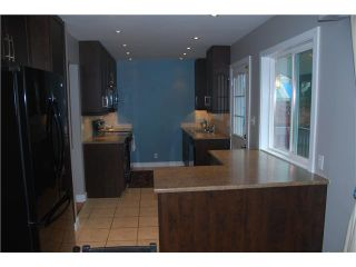 """Photo 2: 2130 COMO LAKE Avenue in Coquitlam: Central Coquitlam House for sale in """"MUNDY PARK"""" : MLS®# V1098166"""