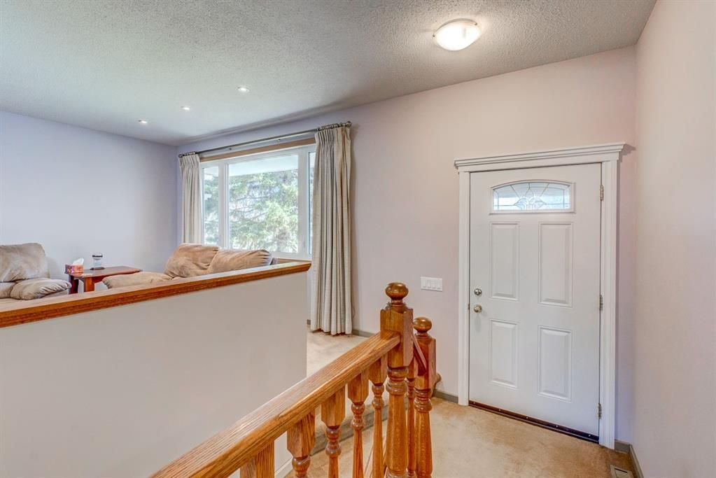 Photo 18: Photos: 499 Canterbury Drive SW in Calgary: Canyon Meadows Detached for sale : MLS®# A1107365