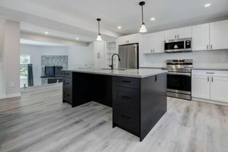 Photo 2: 92 23 Glamis Drive SW in Calgary: Glamorgan Row/Townhouse for sale : MLS®# A1153532
