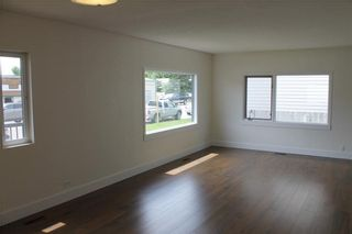 Photo 13: 1014 Nanton Avenue: Crossfield House for sale : MLS®# C4123826