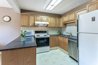 Photo 7: 1413 Ranchlands Road NW in Calgary: Ranchlands Row/Townhouse for sale : MLS®# A1133329