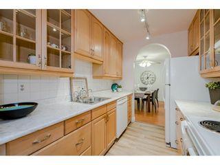 "Photo 1: 309 12890 17 Avenue in Surrey: Crescent Bch Ocean Pk. Condo for sale in ""Ocean Park Place"" (South Surrey White Rock)  : MLS®# R2607831"